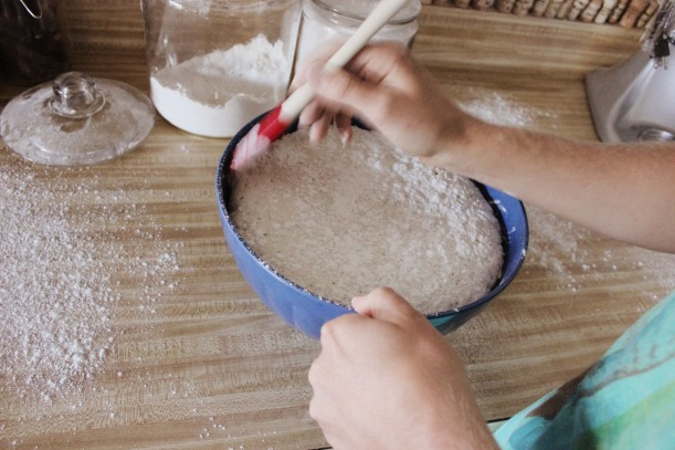 Using a spatula, work your way around the outside of the dough to separate from the side of the bowl