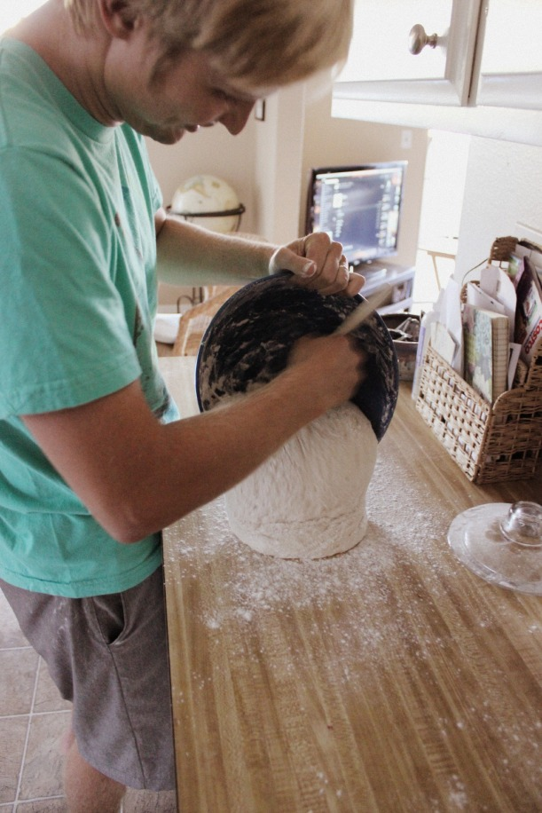 Miles getting the dough out of the bowl onto floured surface