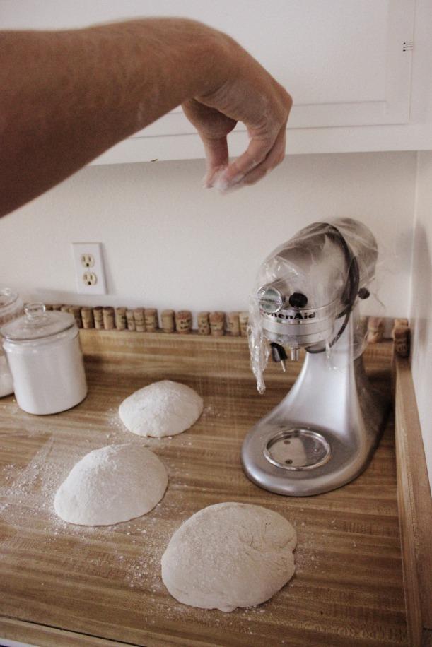 Sprinkle each dough ball with a little flour